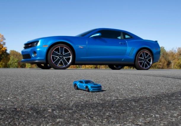 A blue Camaro next to a Hot Wheels replica