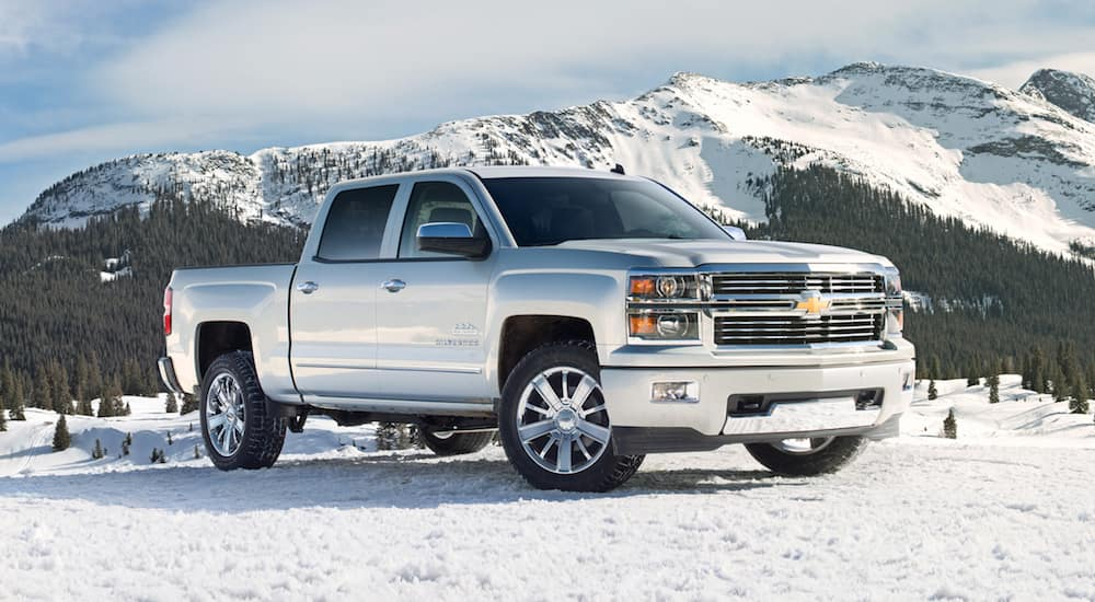 A White 2014 Chevrolet Silverado on a Snowy Mountainside