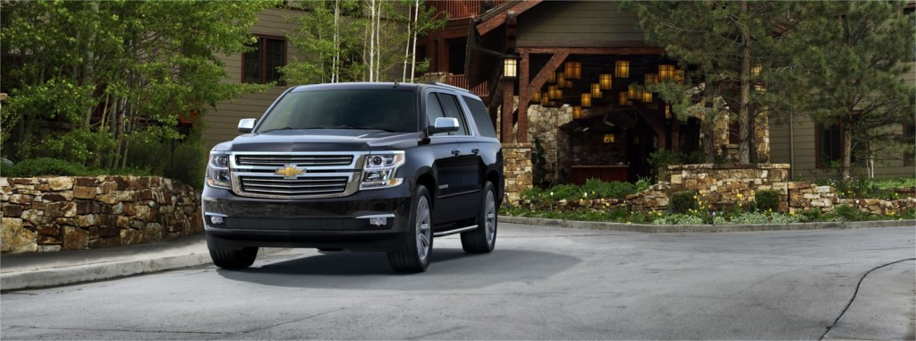 Black 2015 Chevy Suburban in front of a house Indianapolis Chevy dealers