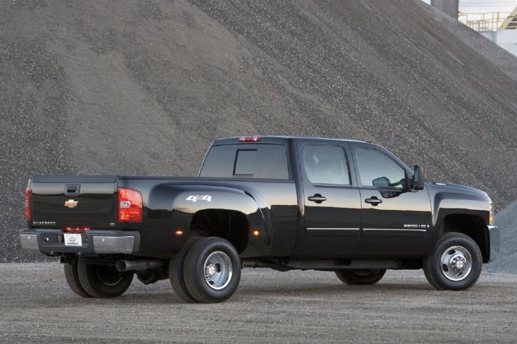 A black Silverado dually at a gravel pit used car lots Cincinnati Ohio