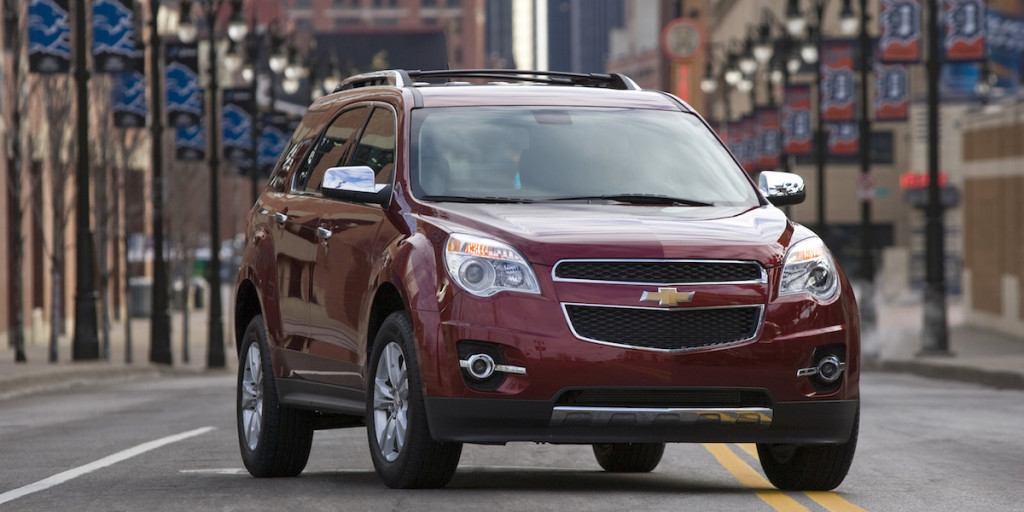 Red 2010 Chevy Equinox in a city