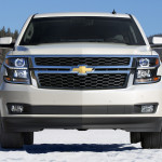 White 2016 Chevy Tahoe in the snow