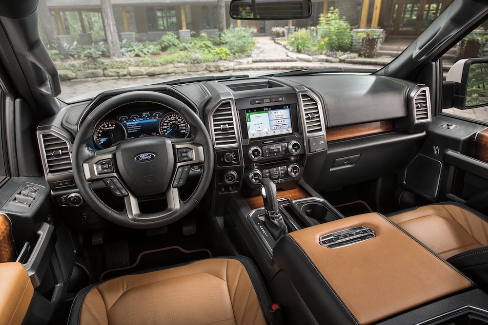 The black and tan leather interior of a 2016 Ford F-150 is shown.