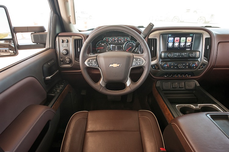 The brown leather interior of a 2016 Chevrolet Silverado 1500 is shown.