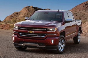 A red 2016 Chevrolet Silverado 1500 LTZ Z71 is parked in front of rocky hills after winning the 2016 Chevrolet Silverado vs 2016 Ford F-150 comparison.