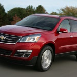 A red 2016 Chevy Equinox is driving on a highway outside of Cincinnati, OH.