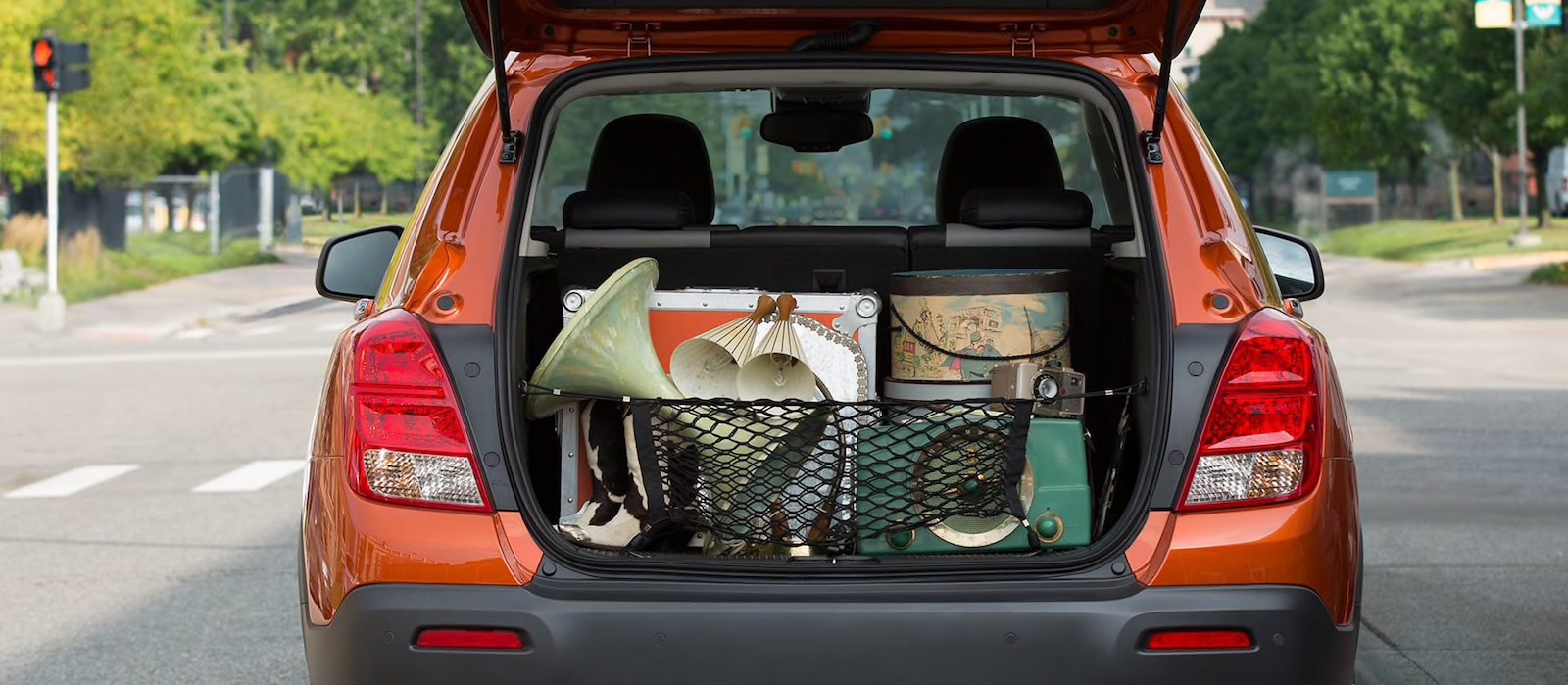 Orange 2016 Chevy Trax with open trunk