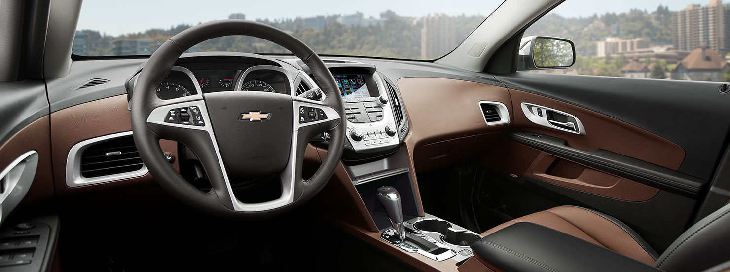 The brown and black interior of the 2017 Chevy Equinox is shown.