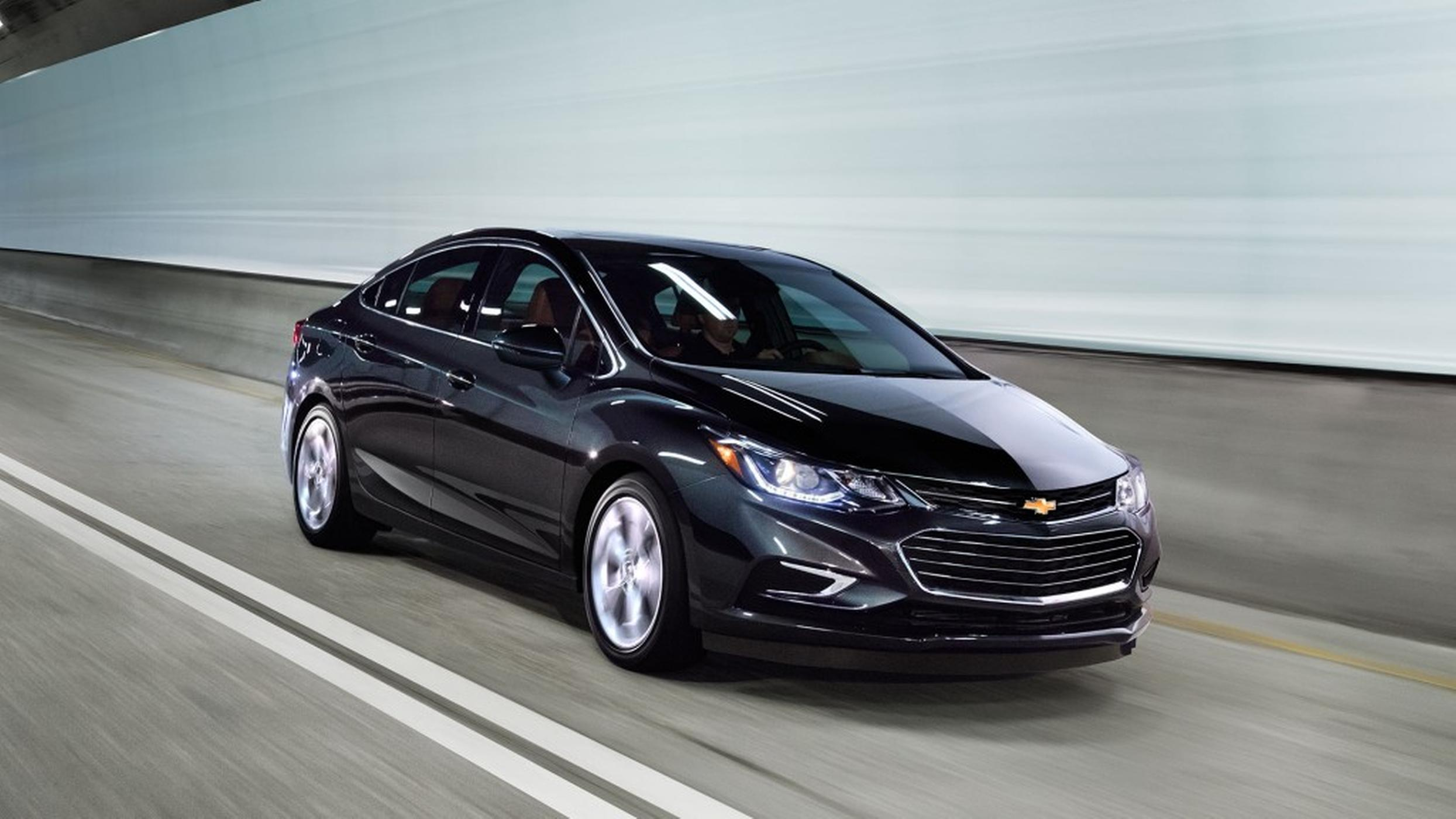 A black 2017 Chevy Cruze is driving on a highway near Cincinnati, OH.