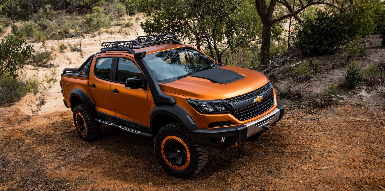 A 2016 Chevy Colorado is driving on a wooded trail near Cincinnati, OH.