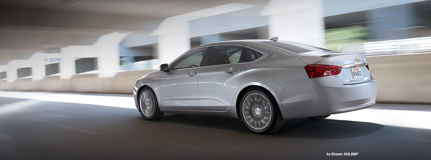A grey 2017 Chevy Impala is driving down a highway near Cincinnati, OH.