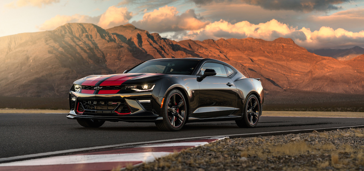 A black and red 2017 Chevy Camaro is parked with mountains in the background.