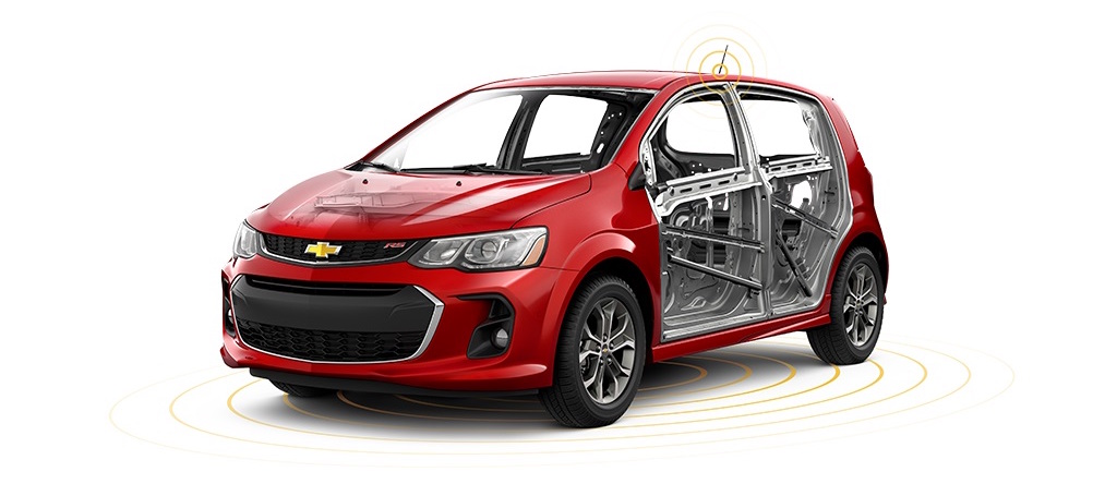 A red 2017 Sonic is parked and high tech safety features are shown.