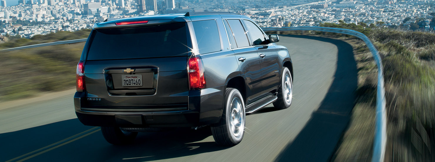 A black 2017 Chevy Tahoe is driving on a highway outside of Cincinnati, OH.