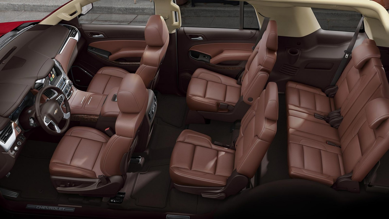 A birds-eye-view of the interior of the 2017 Chevy Tahoe with red leather and brown trim, as seen in the highest trim level.