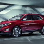 A red 2018 Chevrolet Equinox driving in a tunnel