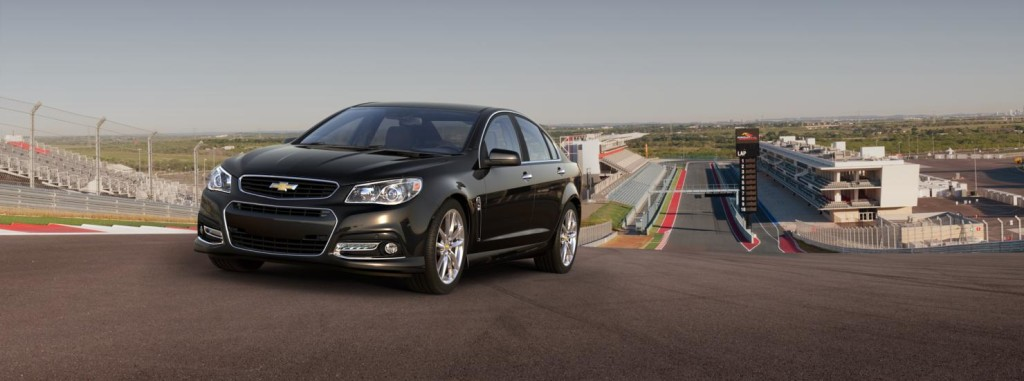 A black Chevy SS is on a racetrack.