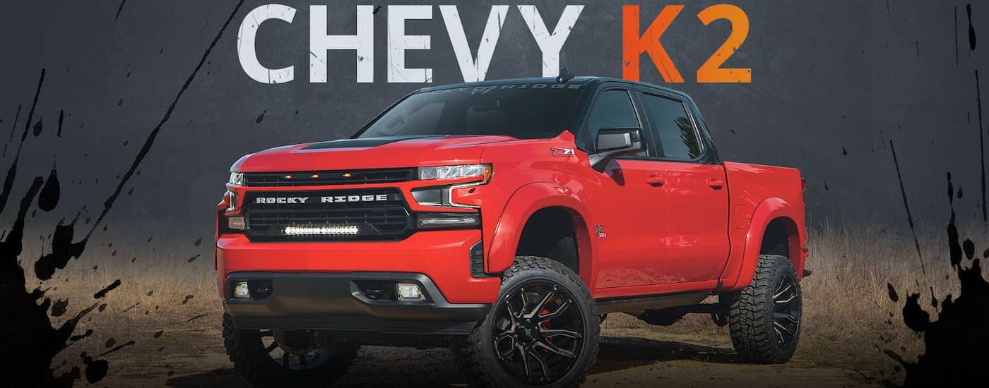 A lifted red Rocky Ridge K2 version of a 2020 Chevy Silverado is shown.