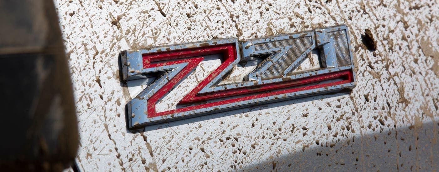 A closeup is shown of the Z71 badging covered in mud on a 2020 Chevy Silverado in Cincinnati.