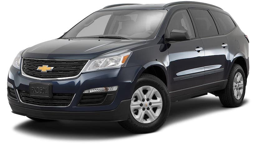 A dark blue 2016 Chevy Traverse is angled left on a white background.