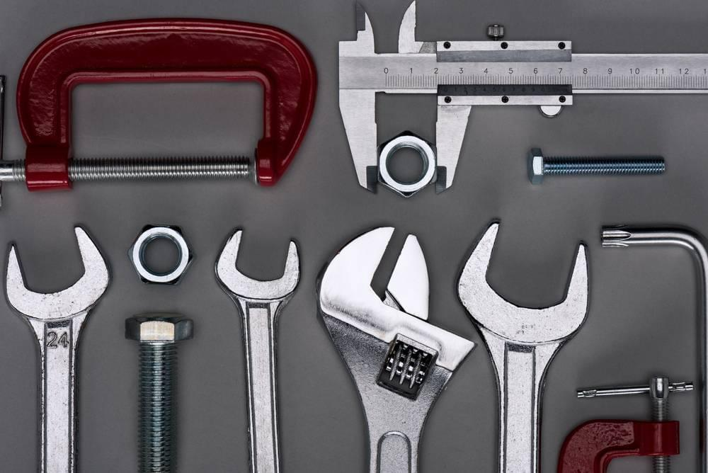 Multiple tools are shown on a gray background in Cincinnati.