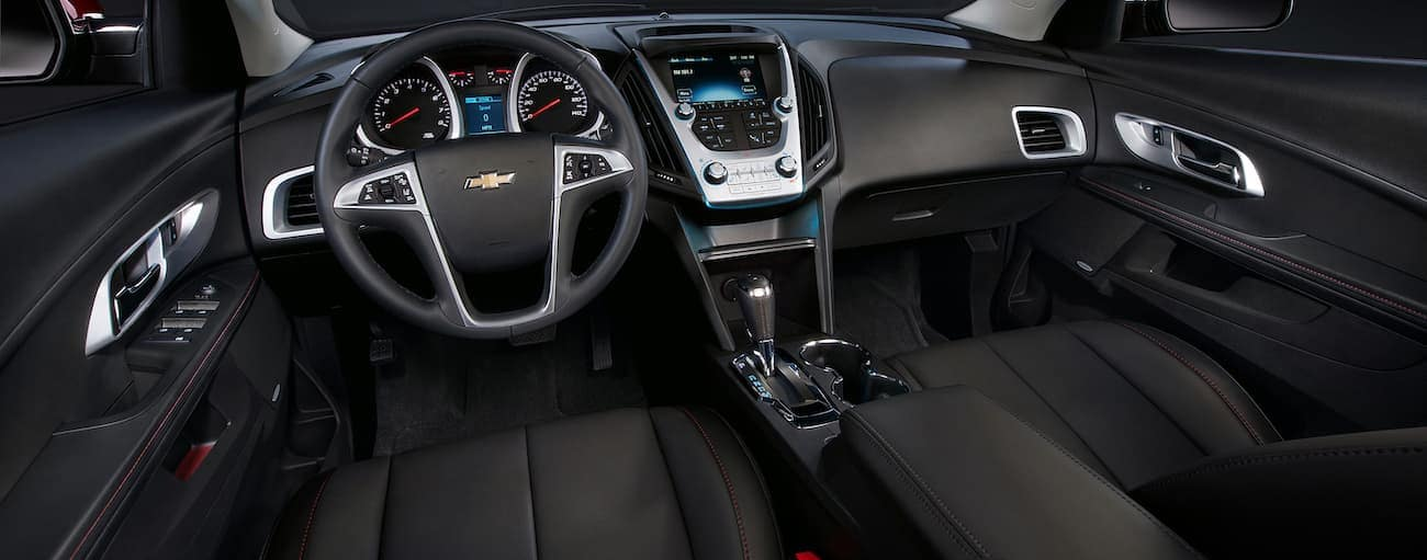 The dashboard and infotainment features in a 2017 Chevy Equinox are shown.