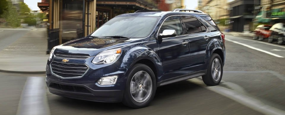 A blue 2017 Chevy Equinox, one of the best SUVs, is driving around a Cincinnati street.