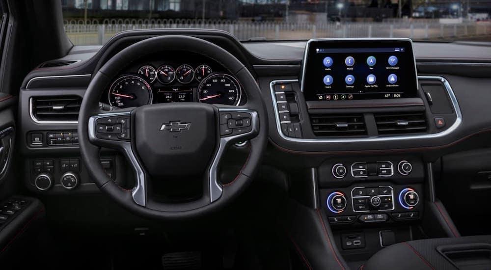 The black interior is shown in a Best SUV 2021 Chevrolet Tahoe in Cincinnati at night.