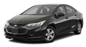 A black 2018 Chevy Cruze is parked and facing left.