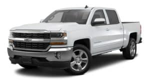 A white 2018 Chevy Silverado is parked and facing left.