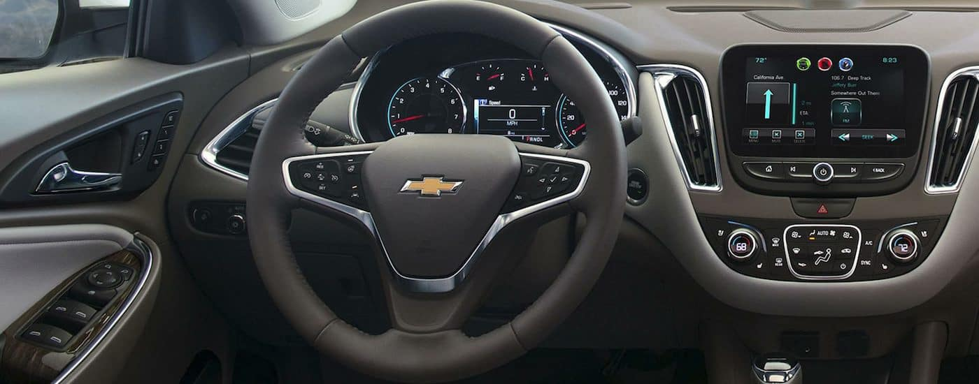 The black and grey interior of a 2018 Chevy Malibu top trim level.