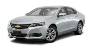A silver 2018 Chevy Impala is parked and facing left.