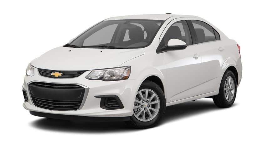 A white 2018 Chevy Sonic is parked and facing left.