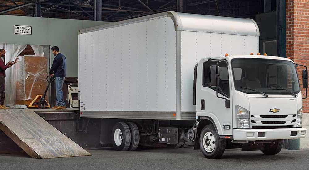 A White Chevy Box Truck at a loading dock