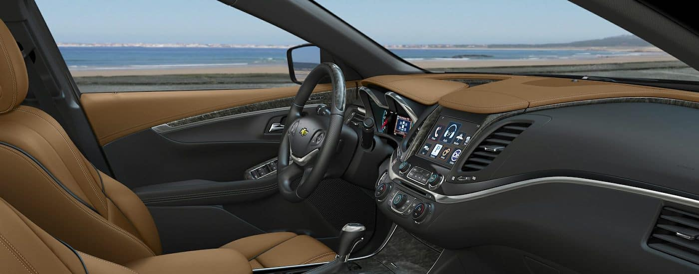 A view of the front dashboard with a touchscreen and other upgraded tech.