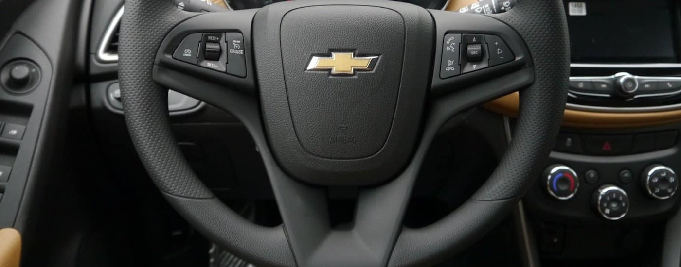 A close up of the black steering wheel inside the 2018 Trax.