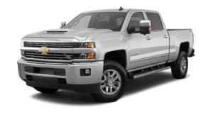 A silver 2018 Chevy Silverado 2500HD is parked and facing left.