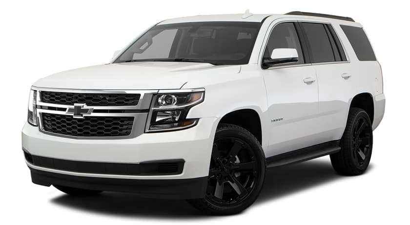 A white 2018 Chevy Tahoe is parked and facing left.
