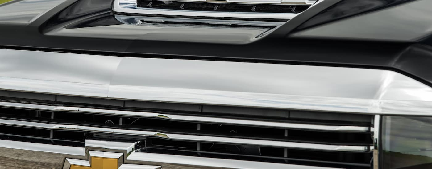 A close up of a the front end with chrome accents and black paint.