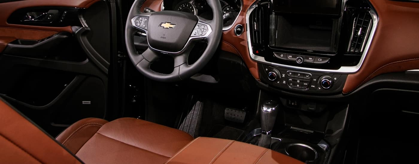 The red/brpwn interior trim of the 2018 Chevy Tahoe.