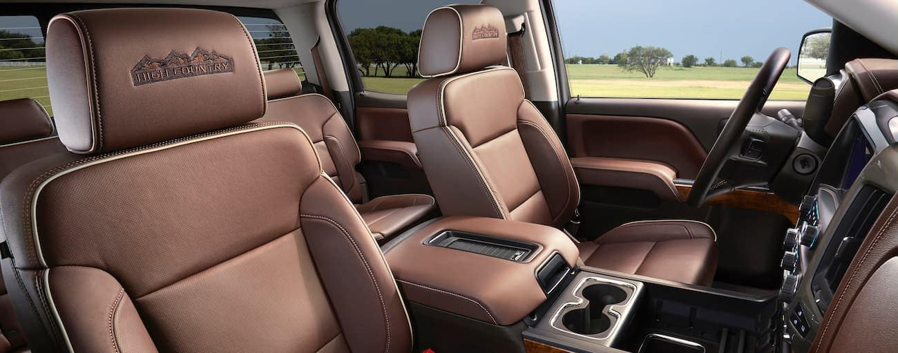 The brown leather interior of a 2018 Chevrolet Silverado is shown.