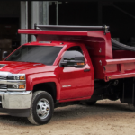 Red 2018 Chevy Silverado dump truck at worksite in Cincinnati