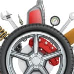 Truck accessories, tire and tools on white background