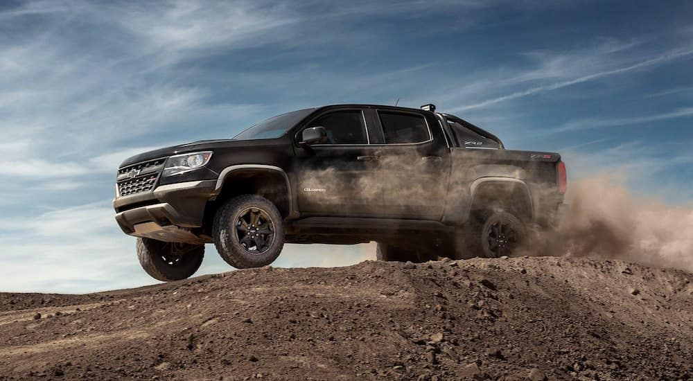 Black 2019 Chevrolet Colorado in air going over dirt jump