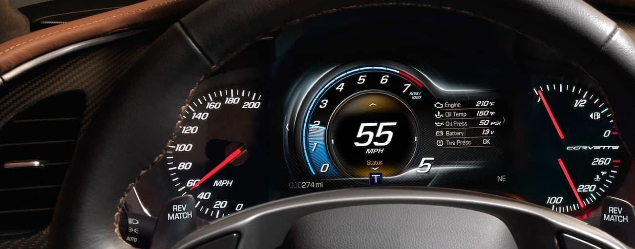 Closeup of driver dashboard through steering wheel of 2019 Chevy Corvette Stingray