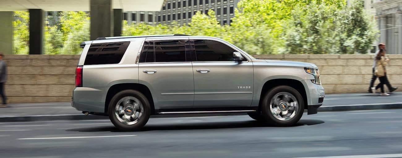 Silver 2019 Chevy Tahoe driving on city street
