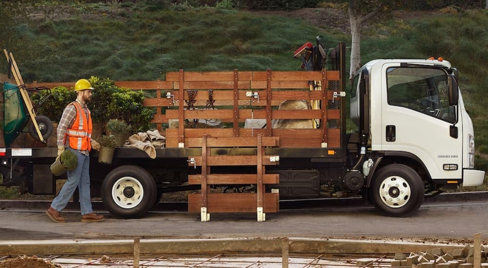 Chevy Low Cab Forward Cab Landscaping truck being loaded by landscapers