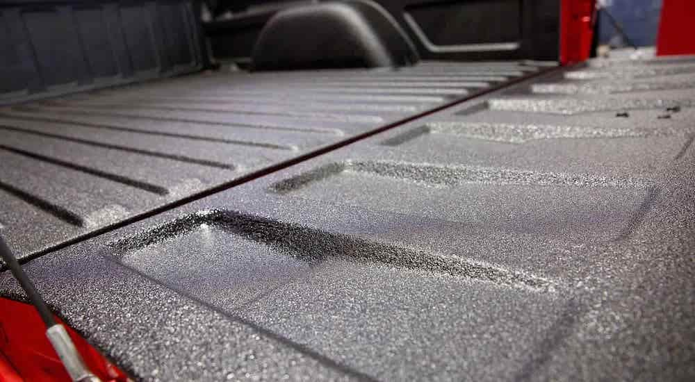 A closeup is shown of a black spray on truck bed liner from McCluskey Chevy in Cincinnati, OH.