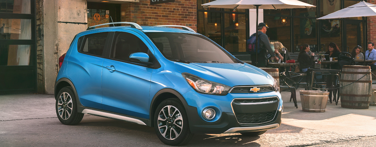Blue 2019 Chevy Spark Activ parked in front of a cafe