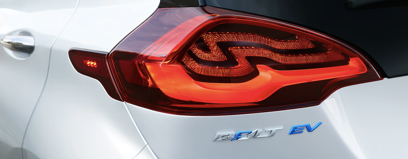 The red tail light of a white 2019 Chevy Bolt